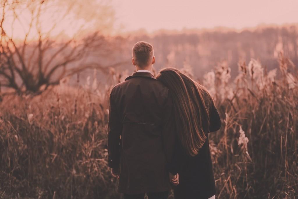 Sensual couple in a field.
